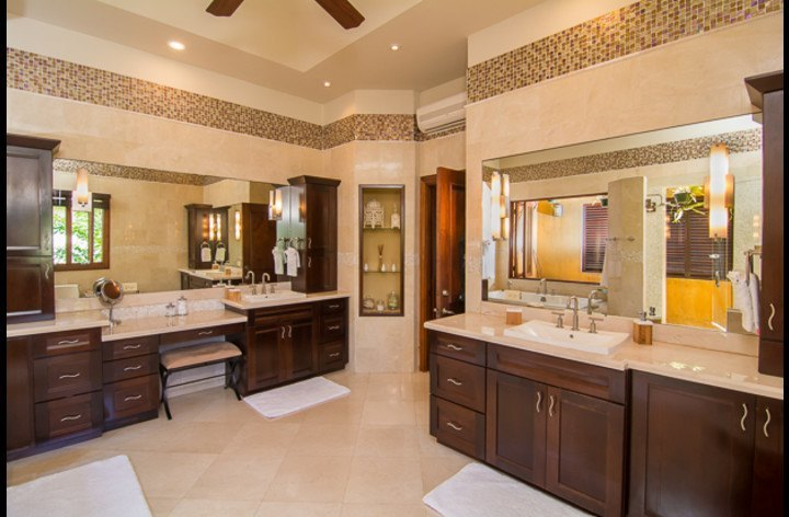 Master bathroom with double sinks and make up area